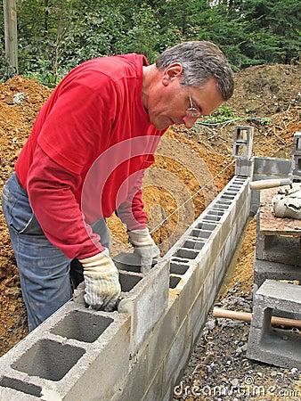 Man Laying Concrete Block Wall Stock Photo - Image: 6615400