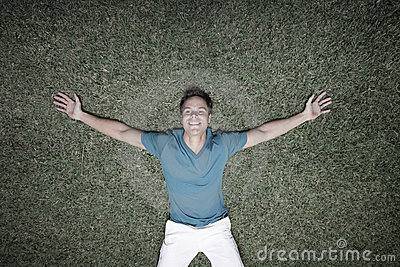 Man laying on the grass
