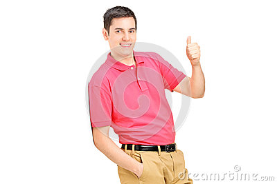 Man leaning against wall and giving a thumb up