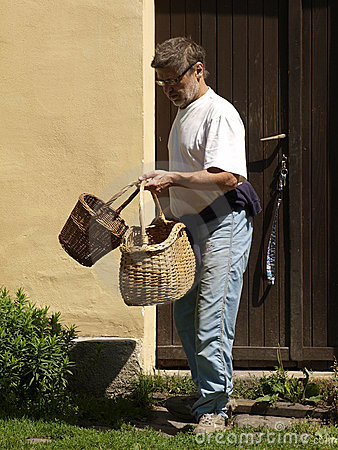 Man leaving home with baskets