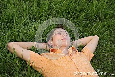 Man lie on the grass