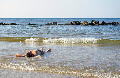 Man lie in sea