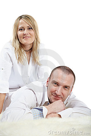 Man lies on carpet, woman sits near Stock Photo