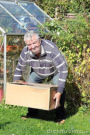 Man lifting heavy box correctly.