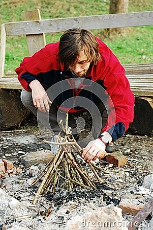 Man lighting fire