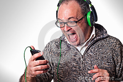 Man listen music on headphones and scream aloud