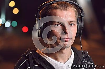 Man listening music at city