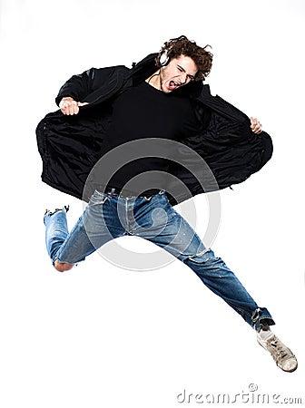 Man listening  music jumping screaming happy