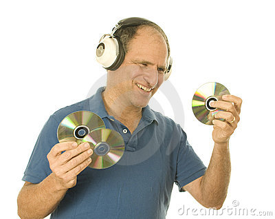 Man listening music vintage head phones