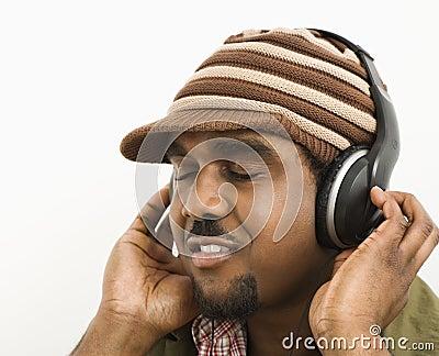 Man listening to headphones.