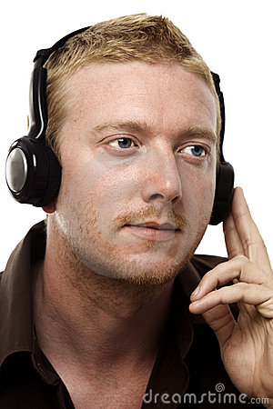Man Listening to his Headphones
