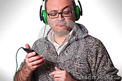 Man listening to music and looking at cell phone