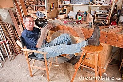 Man listing to radio music in workshop