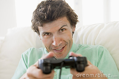 Man in living room playing videogames