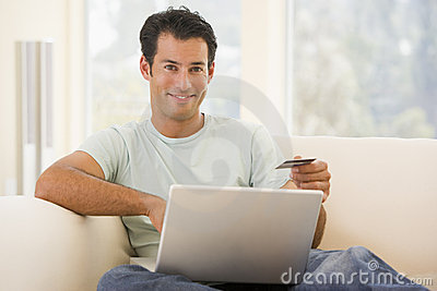 Man in living room using laptop