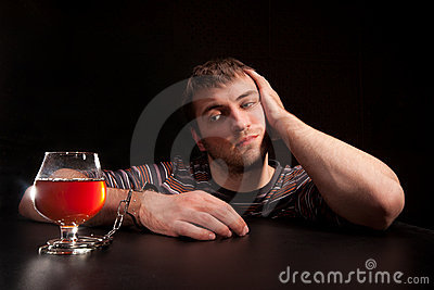 Man locked to glass of alcohol