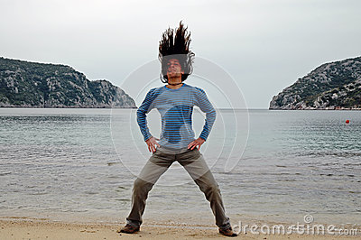 Man with long hair on the beach