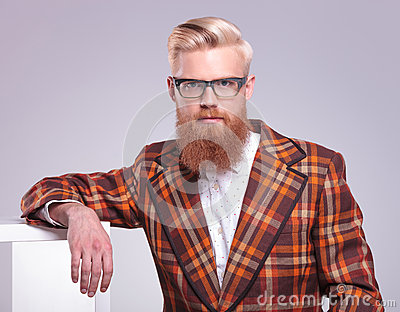 man with long red beard and glasses resting