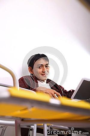 Man look at netbook