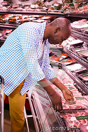 Free Man Looking At Goods In Grocery Section While Shopping Royalty Free Stock Image - 77860896