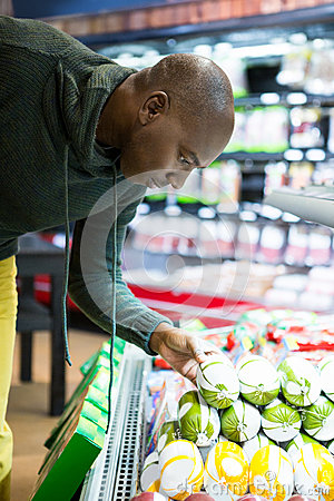 Free Man Looking At Goods In Grocery Section While Shopping Royalty Free Stock Image - 77861386
