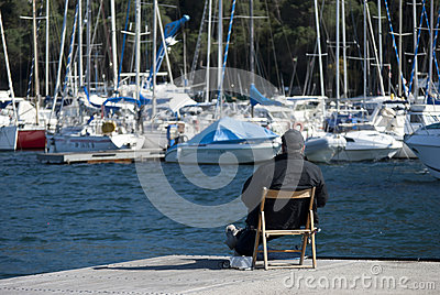 A man looking boats Editorial Photography
