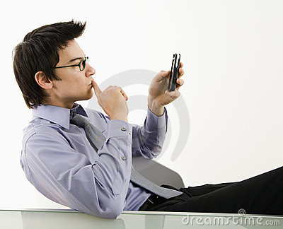 Man looking at cell phone.