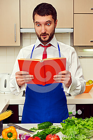 Man looking in cookbook