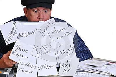 Man looking down at his bills.