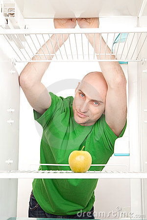 Man looking in empty fridge