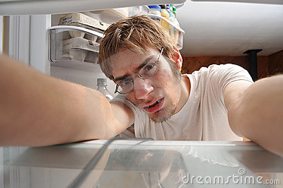 Man looking for food in refrigerator