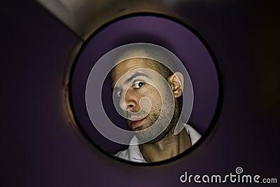 Man looking at a hole