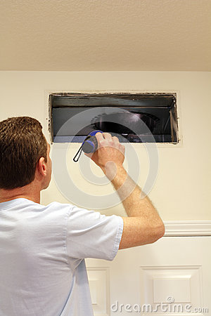 Free Man Looking Into Air Duct Stock Photos - 25596423