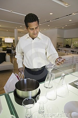 Man looking at Kitchenware in furniture store