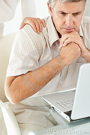 Man looking at laptop in tension