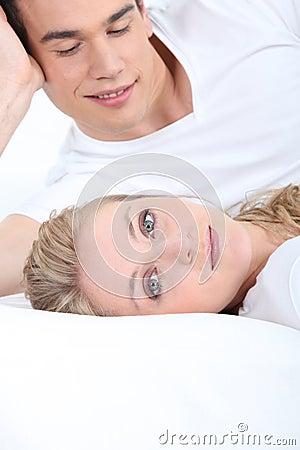 Man looking at lying woman