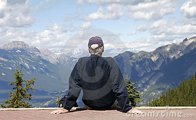 Man looking out on a mountain