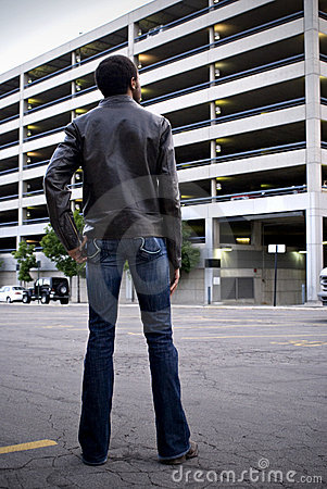 Man looking at parking garage