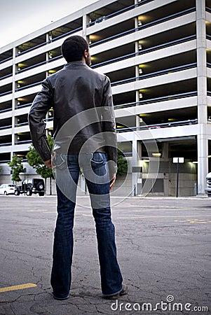Man looking at parking garage