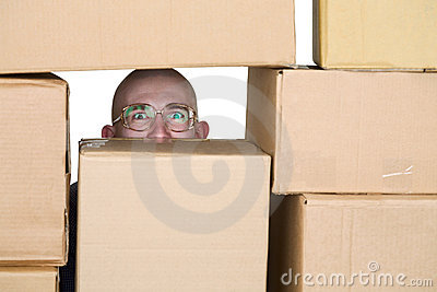 Man looking through pile of cardboard boxes