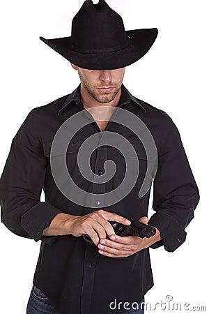Man looking at pistol