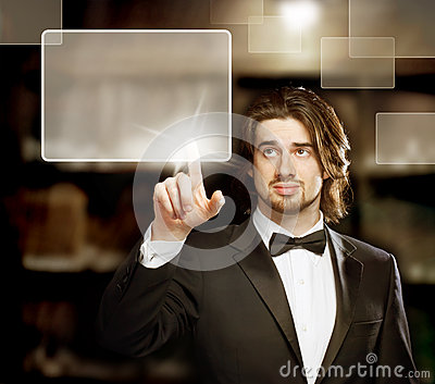 Man Looking and Pointing a Touch Screen