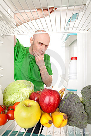 Man Looking into Refrigerator
