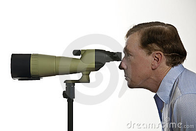 Man looking through spotting scope