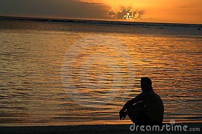Man looking at the sunset over Mauritius