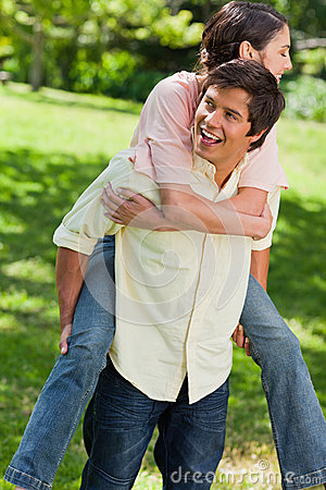 Man looking to his side while carrying his friend on his back