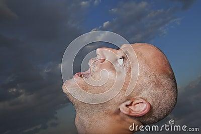 Man looking towards sky