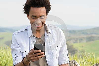 Man Looking Typing On Phone