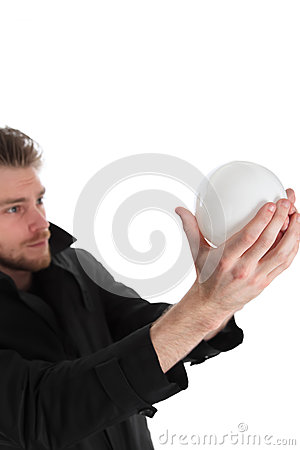 Man looking up into a glass ball