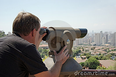 Man Looking Through Viewpoint Telescope.